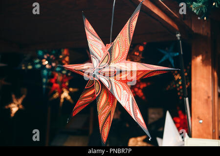 A close-up star is on sale at the Christmas market in Berlin