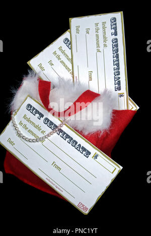 Holiday gift certificate in bag with pearls on black