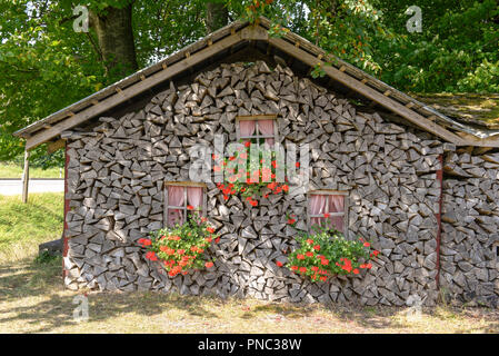 House built with tree trunks at Sachseln on the Swiss alps - Stock Photo