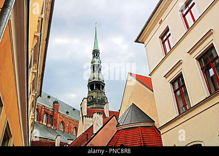 Roofs of buildings in old town and top view of church of St. Peter (St. Peter's Church, Petrikirche), Riga - Stock Photo