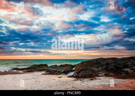Sunset over the beach at Tresaith in Ceredigion, Wales. - Stock Photo