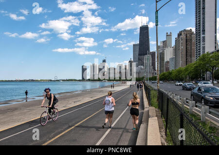 Lakefront Trail on Lake Shore Drive, Lake Michigan,with a view of the Chicago, IL skyline. - Stock Photo