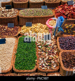 Dried fruits and nuts at market in Barcelona, Spain - Stock Photo