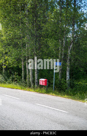 Three mail boxes at a bus stop in Finland on a summer day - Stock Photo