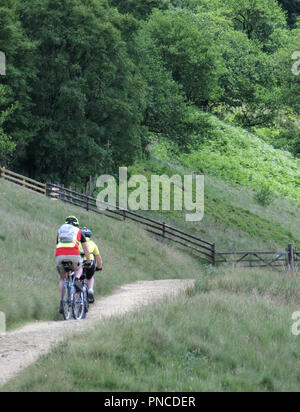 Two Mountain Bikers Mountain Biking in the Upper Derwent Valley Peak District National Park, South Yorkshire, England, UK in June - Stock Photo