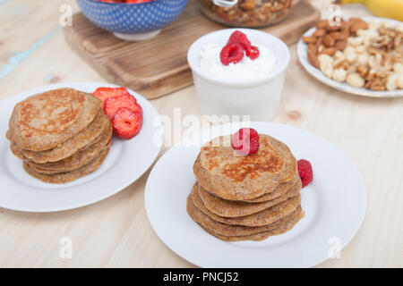 Breakfast: paleo style grain free banana almond pancakes, coconut yogurt with berries, selective focus - Stock Photo