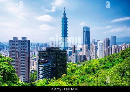 April 1, 2018.  Taipei, Taiwan.  The Taipei 101 landmark building rising above generic architecture in the city of Taipei Taiwan on a sunny day as see - Stock Photo