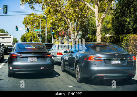 September 11, 2018 Palo Alto / CA / USA - Two Tesla cars (Model S and Model 3) driving on the streets of Silicon Valley, south San Francisco bay area - Stock Photo