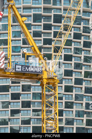 Construction crane on construction site building new high rise apartment towers in Downtown Dubai, UAE, United Arab Emirates, - Stock Photo