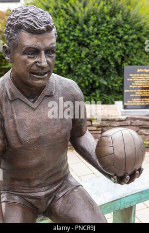 Sneem, Republic of Ireland - August 17th 2018: A statue of famous Gaelic footballer John Egan, in the village of Sneem in Ireland - near where he was  - Stock Photo