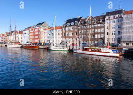 Nyhavn, 17th-century waterfront, canal and entertainment district,  with Colourful façades, Copenhagen, Denmark - Stock Photo