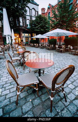 Famous Water Castle Restaurant in Speicherstadt, Outside. Tables and chairs at cobbled square. Hamburg, Germany - Stock Photo