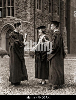 1930s 1940s GROUP COLLEGE GRADUATES ONE WOMAN TWO MEN WEARING MORTARBOARD CAPS HATS AND GOWNS HOLDING DIPLOMAS TALKING TOGETHER - s6203 HAR001 HARS JOY LIFESTYLE SATISFACTION CELEBRATION FEMALES COPY SPACE FULL-LENGTH LADIES PERSONS MALES CONFIDENCE GRADUATES B&W SUCCESS DREAMS HAPPINESS ROBES VICTORY UNIVERSITIES EXCITEMENT KNOWLEDGE GOWNS PRIDE HIGHER EDUCATION CAPS STYLISH COLLEGES MORTARBOARD DIPLOMAS GROWTH TOGETHERNESS YOUNG ADULT MAN YOUNG ADULT WOMAN BLACK AND WHITE CAUCASIAN ETHNICITY HAR001 OLD FASHIONED - Stock Photo
