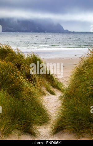 A view through the dunes to Keel Beach on Achill Island in County Mayo, Ireland. - Stock Photo