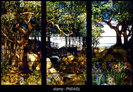 A Wooded Landscape in Three Panels. Date/Period: Ca. 1905. Glasswork. Glass, copper-foil, lead Glass, copper-foil, lead. Height: 2,197.10 mm (86.50 in); Width: 3,341.69 mm (10.96 ft). Author: LOUIS COMFORT TIFFANY. TIFFANY, LOUIS COMFORT. - Stock Photo