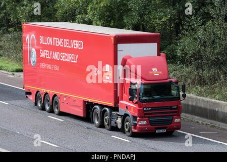 Royal Mail HGV Heavy goods lorries, trucks & trucking,  logistics, postal services,  transport vehicles on the M6 at Lancaster, UK - Stock Photo