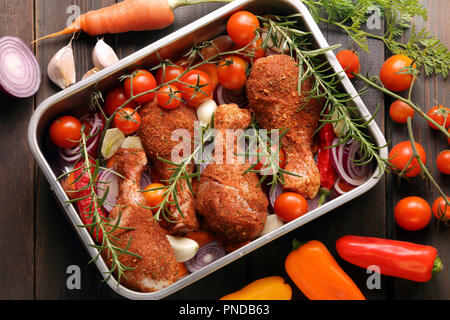 Raw marinated chicken drumsticks legs ready for bake or grill and bbq - Stock Photo