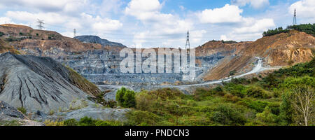 Panoramic wide angle view of a quarry. Quarry is a type of open-pit mine in which dimension stone, rock, construction aggregate, riprap, sand, gravel. - Stock Photo
