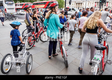 London England Great Britain United Kingdom St. Saint James's Trafalgar Square street crossing walking Trailgator bicycle trailer cyclist woman boy mo - Stock Photo
