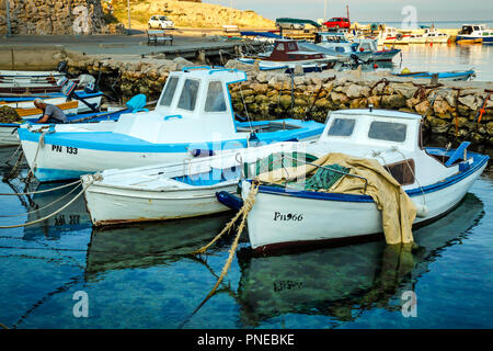 Small fishing boats on the old waterfront at Punat on the Croatian island of Krk - Stock Photo