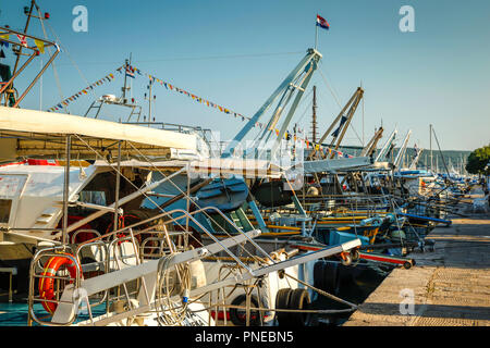 Boats moored in the commercial marina on the Adriatic Sea on the outskirts of Punat on the Croatian island of Krk - Stock Photo
