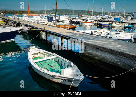 Boats moored in the commercial marina on the Adriatic Sea, on the outskirts of Punat on the Croatian island of Krk - Stock Photo