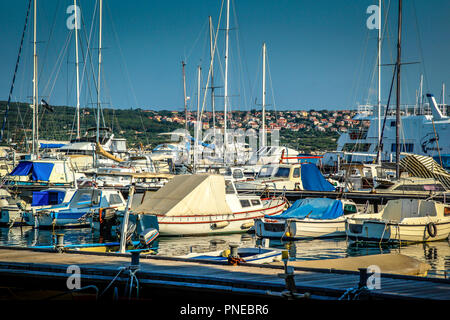 Boats moored in a commercial marina on the Adriatic Sea, on the outskirts of Punat on the Croatian island of Krk - Stock Photo