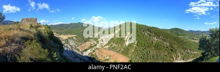 A landscape of cultivated fields, dense forest and mountains as seen from the castle of the rural medieval town of Boltaña, in the Spanish Pyrenees - Stock Photo