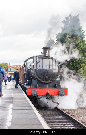 Kidderminster, UK. 21st September, 2018. Day two of Severn Valley Railway's Autumn Steam Gala sees excited crowds flocking to the Kidderminster SVR station. Despite the rain showers, train enthusiasts take every opportunity to capture today's memory of these colossal visiting steam locomotives, particularly the Duchess of Sutherland looking resplendent in her fine crimson livery. Credit: Lee Hudson/Alamy Live News - Stock Photo