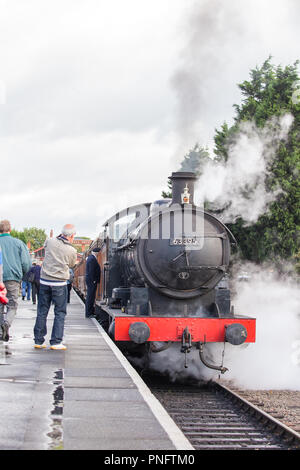 Kidderminster, UK. 21st September, 2018. Day two of Severn Valley Railway's Autumn Steam Gala sees excited crowds flocking to Kidderminster SVR heritage railway station. Despite the rain showers, train enthusiasts take every opportunity to capture today's memory of these colossal visiting UK steam locomotives. On loan from the North York Moors Railway, the Q6 steam engine 63395 waits alongside the platform ready for departure. Credit: Lee Hudson/Alamy Live News - Stock Photo