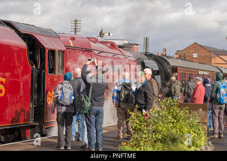 Kidderminster, UK. 21st September, 2018. Day two of Severn Valley Railway's Autumn Steam Gala sees excited crowds flocking to Kidderminster SVR vintage station. Despite the rain showers, train enthusiasts take every opportunity to capture today's memory of these colossal visiting UK steam locomotives, particularly the Duchess of Sutherland looking resplendent in her fine crimson livery. Credit: Lee Hudson/Alamy Live News - Stock Photo