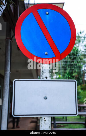 Metal Plate, Traffic Prohibitory Sign: Parking is prohibited, No Parking. The sign, usually shown as a red diagonal bar inside a blue circle with a re - Stock Photo