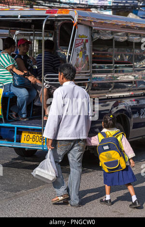Songthaew taxi and passengers, Pattaya, Thailand - Stock Photo