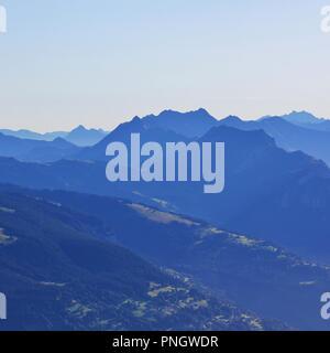 Distant view of Beatenberg, Habkern, Mount Augstmatthorn and Brienzer Rothorn, Bernese Oberland. Morning view from Mount Niesen. Switzerland. - Stock Photo