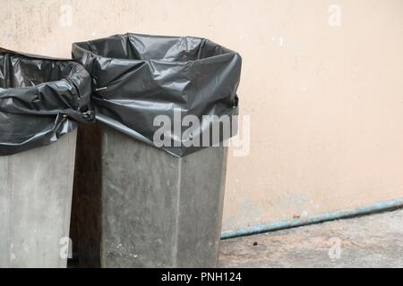 black garbage bag plastic wear in trashcan - Stock Photo
