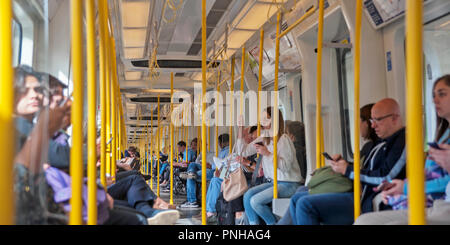 Inside a moving London Underground train on open section of line. - Stock Photo