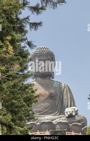 The Big Buddha statue in Ngong Ping village - Lantau Island Hong Kong - Stock Photo