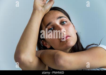 Beauty shot of mixed race young woman. Close up. Looking at camera. - Stock Photo