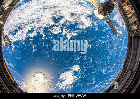 Beautiful planet Earth seen from space. Contrasting blue and yellow over the surface. This image is a NASA handout - Stock Photo