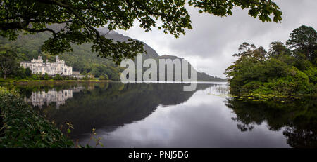 County Galway, Ireland - August 20th 2018: A panoramic view of the magnificent Kylemore Abbey - the Benedictine monastery in Connemara, County Galway, - Stock Photo