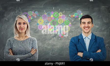 Man and woman sharing thoughts together as colorful cogwheels forming a common gear brain. Employee ideas exchange, business relationship and teamwork - Stock Photo