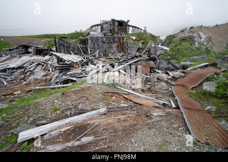 Ruins of an old abandoned mining building at Independence Mine along Alaska's Hatcher Pass - Stock Photo