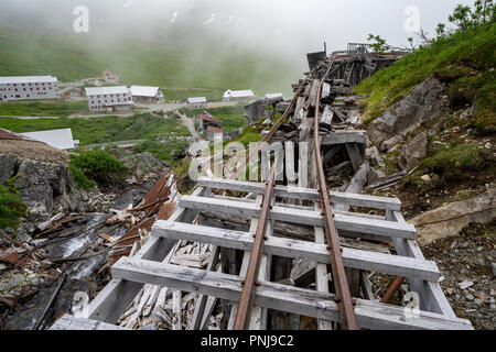 Ruins of an old abandoned mining ore track at Independence Mine along Alaska's Hatcher Pass - Stock Photo