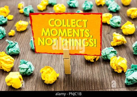 Handwriting text Collect Moments, Not Things. Concept meaning Happiness philosophy enjoy simple life facts Paperclip hold written yellow page colorful - Stock Photo