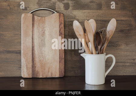 Crockery, white utensils and other different stuff on wooden table-top. Kitchen still life as background for design. Copy space. - Stock Photo