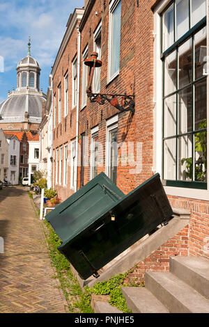 old houses in the schuitvlotstraat in Middelburg, in the foreground wooden shutters are visible, giving access to the cellar under the house - Stock Photo