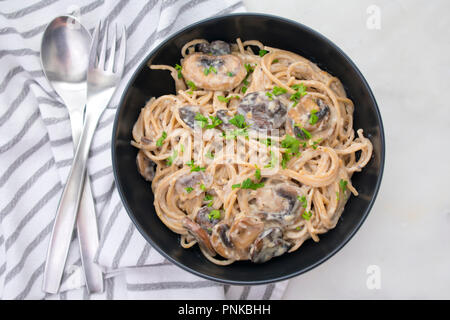 Creamy Garlic Herb Mushroom Spaghetti - Stock Photo