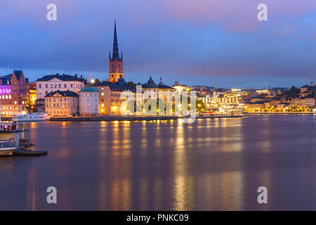 Scenic night view of Riddarholmen, Gamla Stan, in the Old Town in Stockholm, capital of Sweden - Stock Photo
