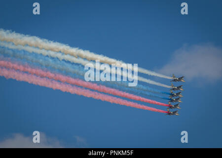 Saint Petersburg, Rusisa - July 29, 2018: Avia parade in Moscow. Group of Russian fighter planes draw russian flag in the sky with coloured smokes - Stock Photo