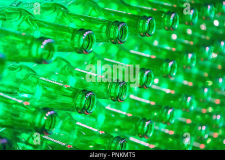 Amsterdam, Netherlands - August 10, 2018 - Heineken beer bottles in brewery museum - Stock Photo